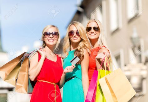 23436438-sale-and-tourism-happy-people-concept-beautiful-blonde-women-with-shopping-bags-in-the-ctiy-Stock-Photo.jpg