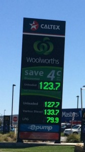 The electronic advertising sign outside the service station on Monday morning showing unleaded petrol at 123.7 cents per litre for customers with a discount, the same price as the supermarket chain's rival Costco.